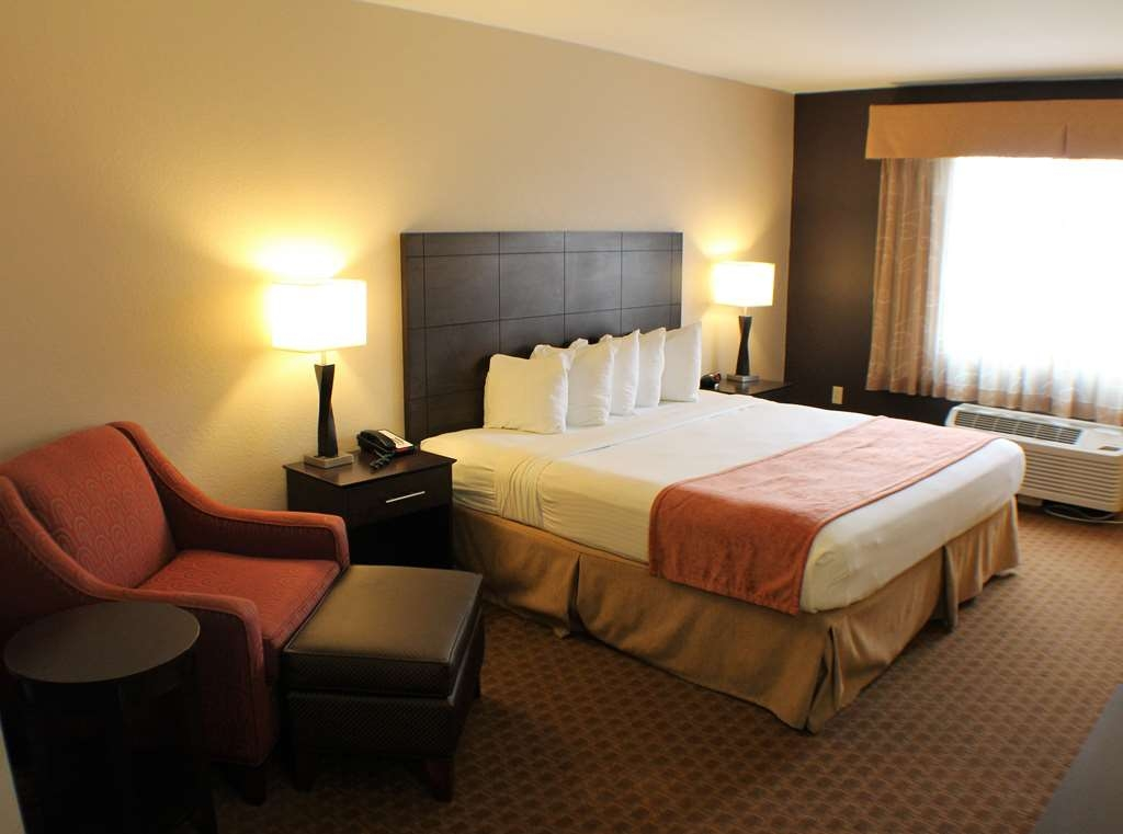 Best Western Lorson Inn - King Suite features a partitioned living area, 2 TVs, kitchenette, and sofa sleeper.