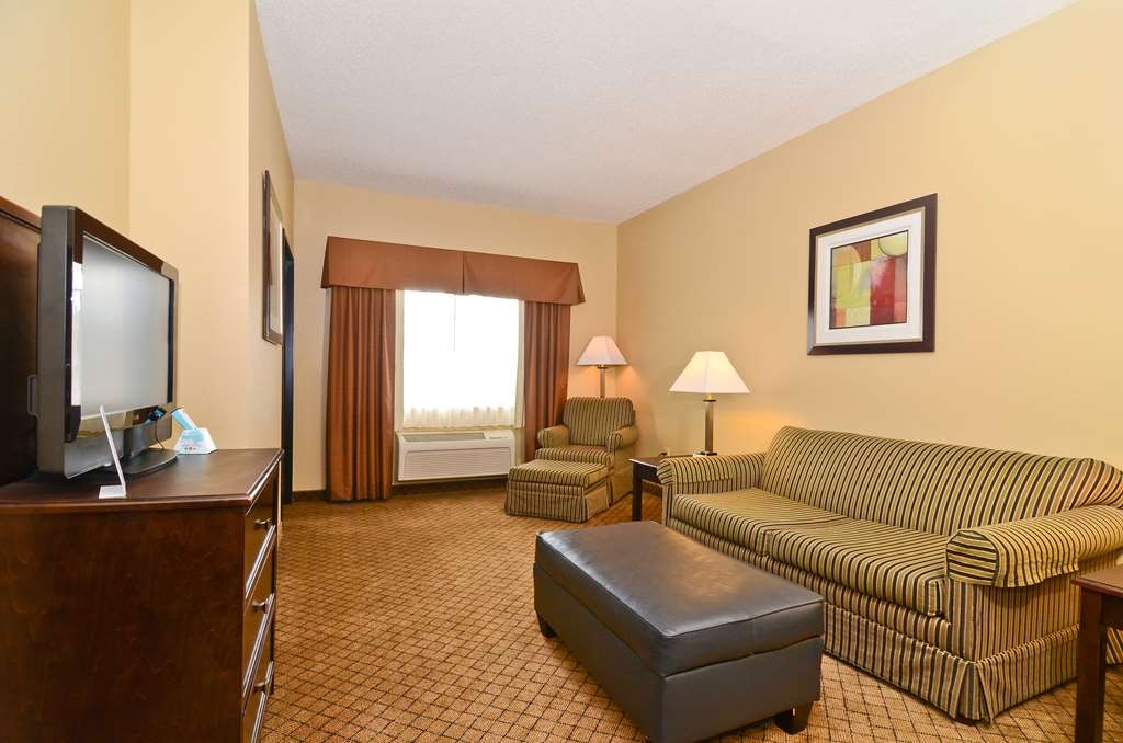 Best Western Macomb Inn - Our King Suite also offers a spacious living area with a sofa sleeper.