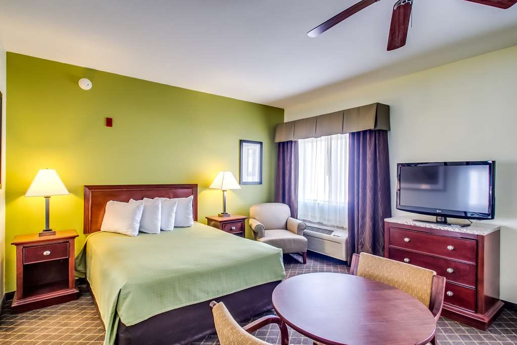 Best Western Geneseo Inn - Large room with king size bed, refrigerator, microwave, sink and flat screen TV. Comfortable sofa and lounging chairs. Just like home.