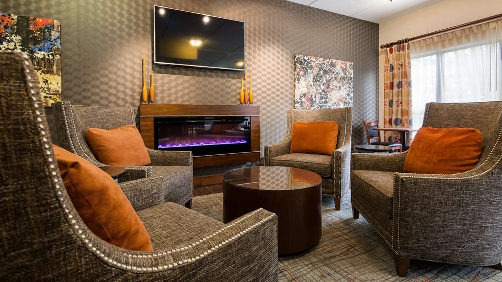 Best Western Delta Inn - Stay warm by the fireplace or settle into one of the comfortable chairs.
