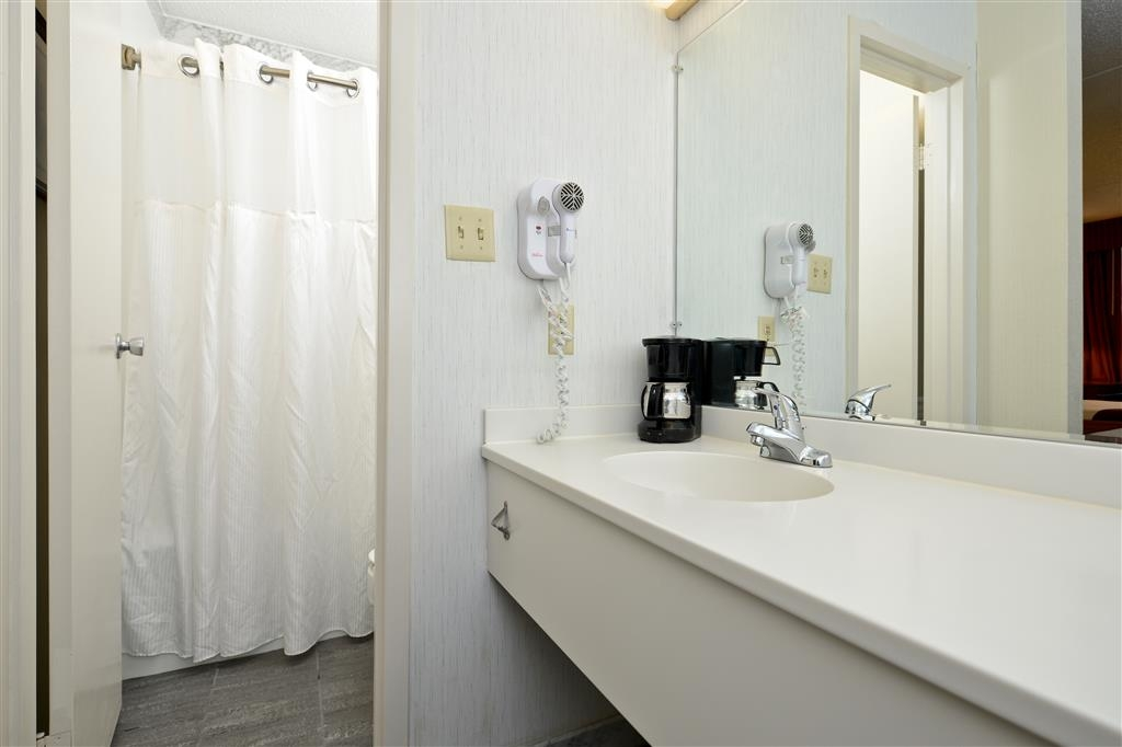 Best Western Inn - The guest bathrooms in our well-appointed accommodations feature luxurious amenities including: vanity area, hair dryer, soft towels, spacious bathtub/shower and complimentary bath products.