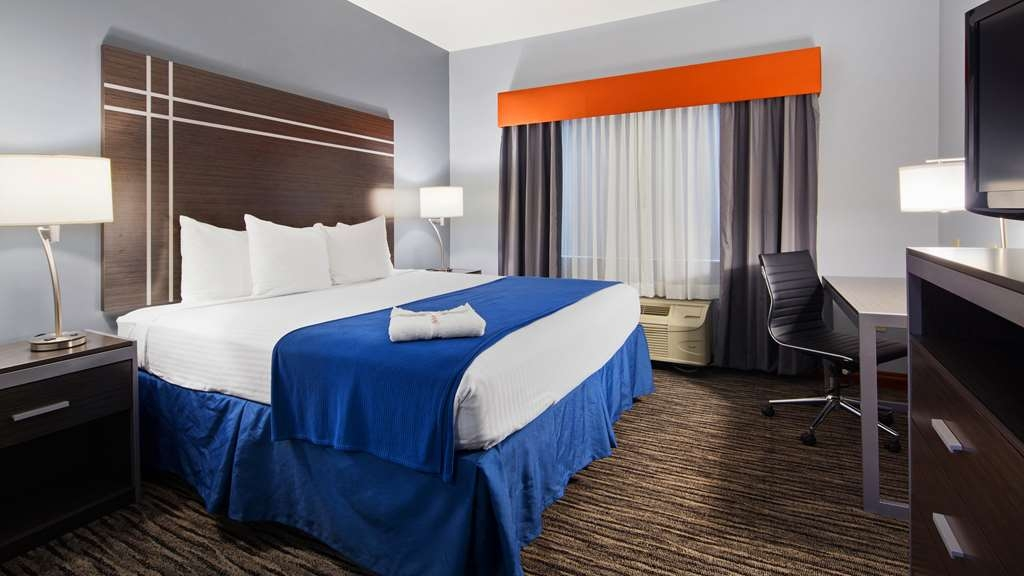 Best Western Inn & Suites - Sink into our comfortable beds each night and wake up feeling completely refreshed.
