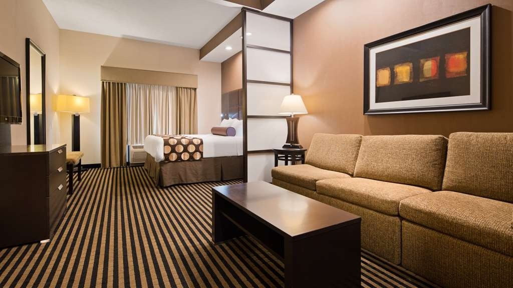 Best Western Plus Atrea Airport Inn & Suites - Stretch out and relax in the One King Suite.