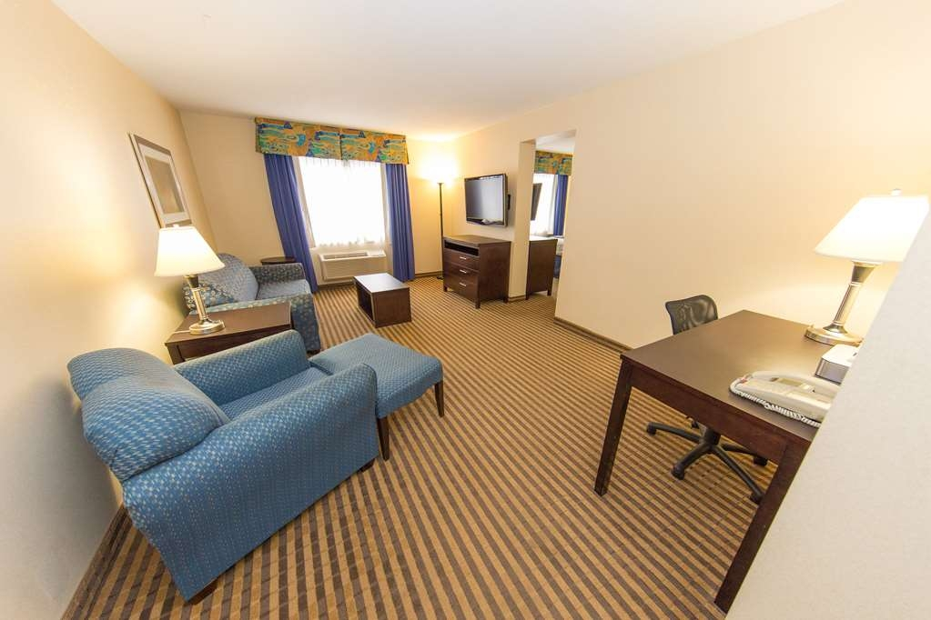 Best Western Plus Portage Hotel & Suites - King Suite Living Room with Pullout Sofa