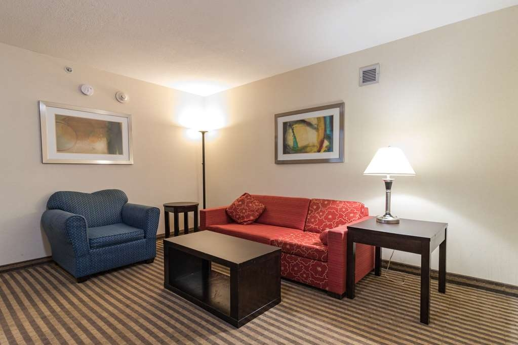 Best Western Plus Portage Hotel & Suites - Queen Suite Living Room with Pullout Sofa