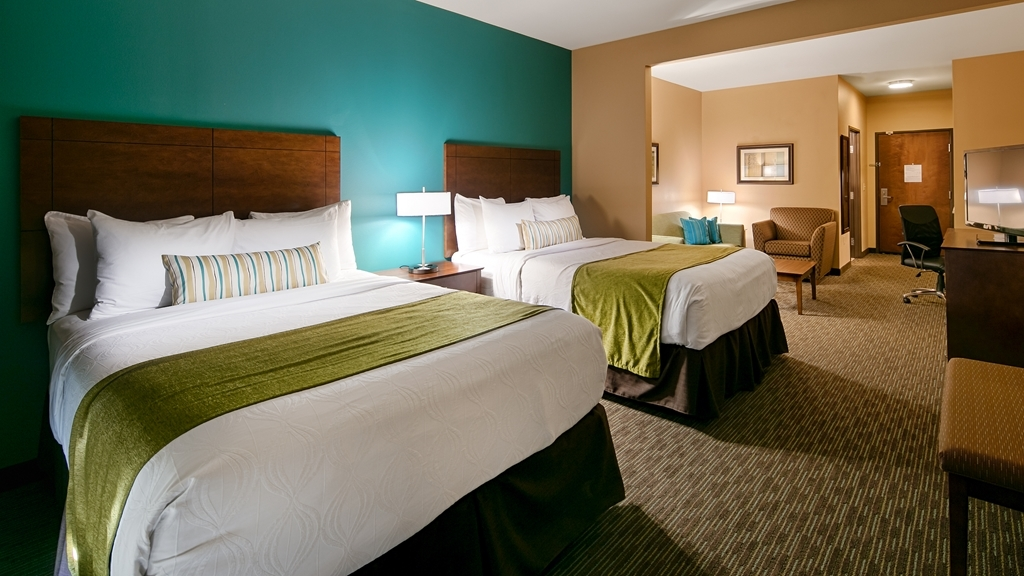 Best Western Plus French Lick - Our expanded double queen guest room with adjacent lounge area has extra sleeping space without the cost of an additional room.