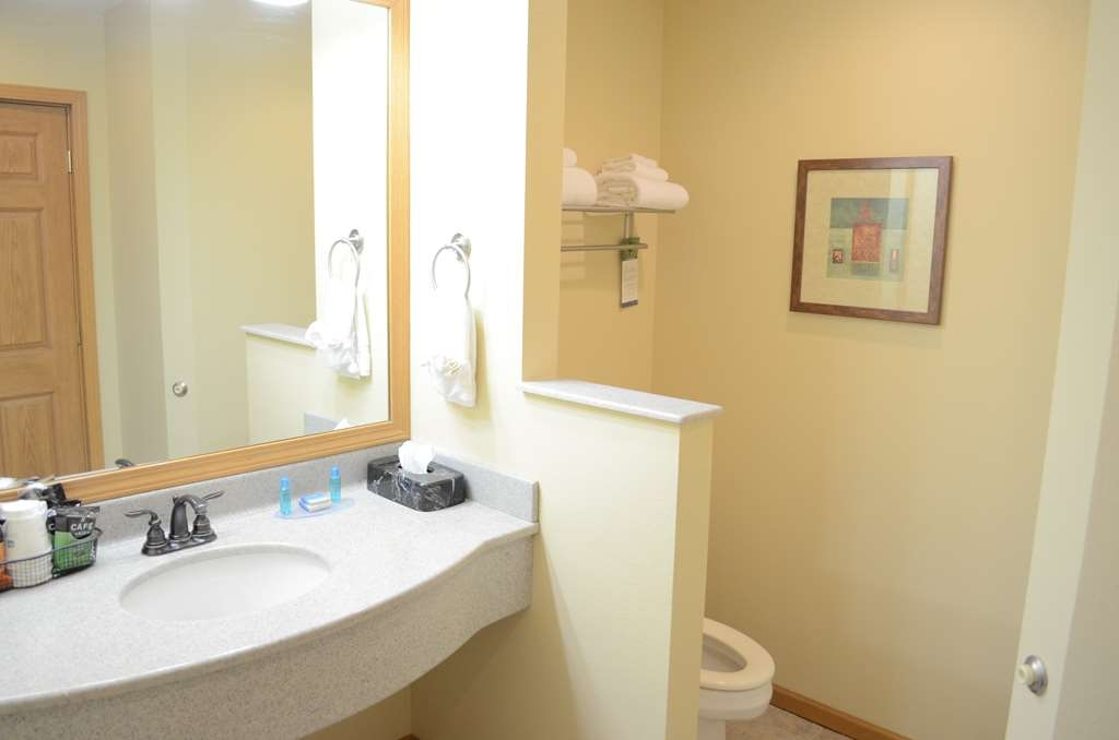 Best Western Starlite Village - Our Timber Club Business King bathroom features spacious vanity and walk in shower with overhead shower and body spray jets.