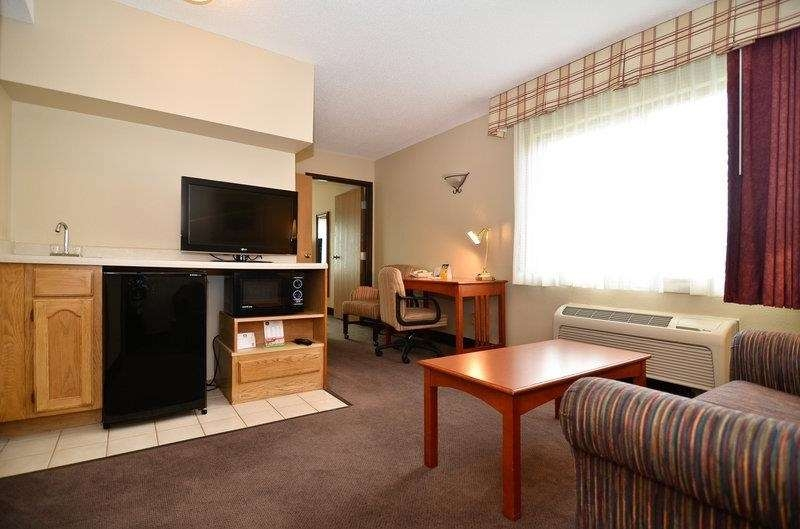 Best Western Plus University Park Inn & Suites - The living room of our executive suite features a TV, microwave, refrigerator and sofa bed.