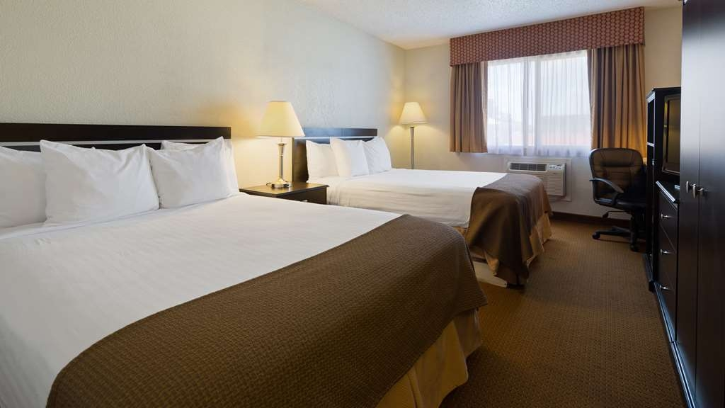 Best Western Mt. Pleasant Inn - Sink into our comfortable beds each night and wake up feeling completely refreshed.