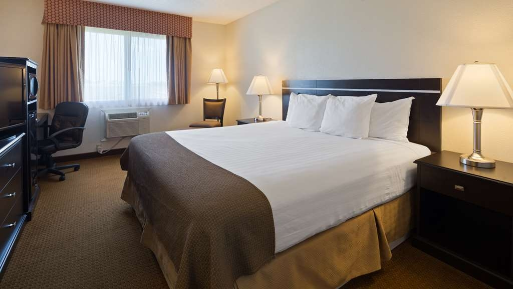 Best Western Mt. Pleasant Inn - Stretch out and relax in the One King Guest Room.