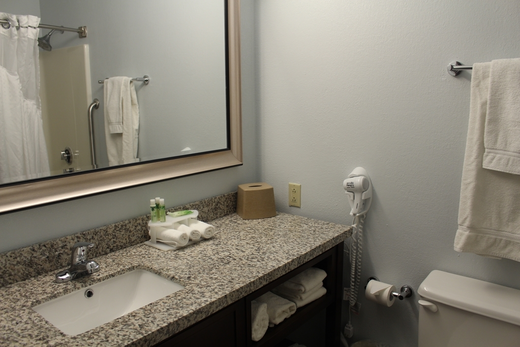 Best Western Holiday Manor - All guest bathrooms have a large vanity with plenty of room to unpack the necessities