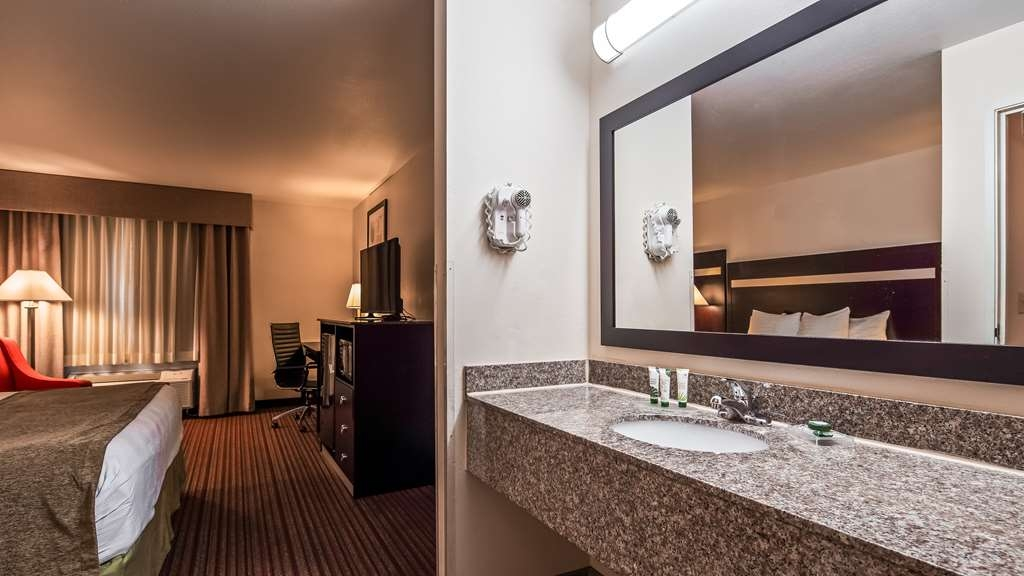 Best Western Parsons Inn - All guest bathrooms have a large vanity with plenty of room to unpack the necessities.