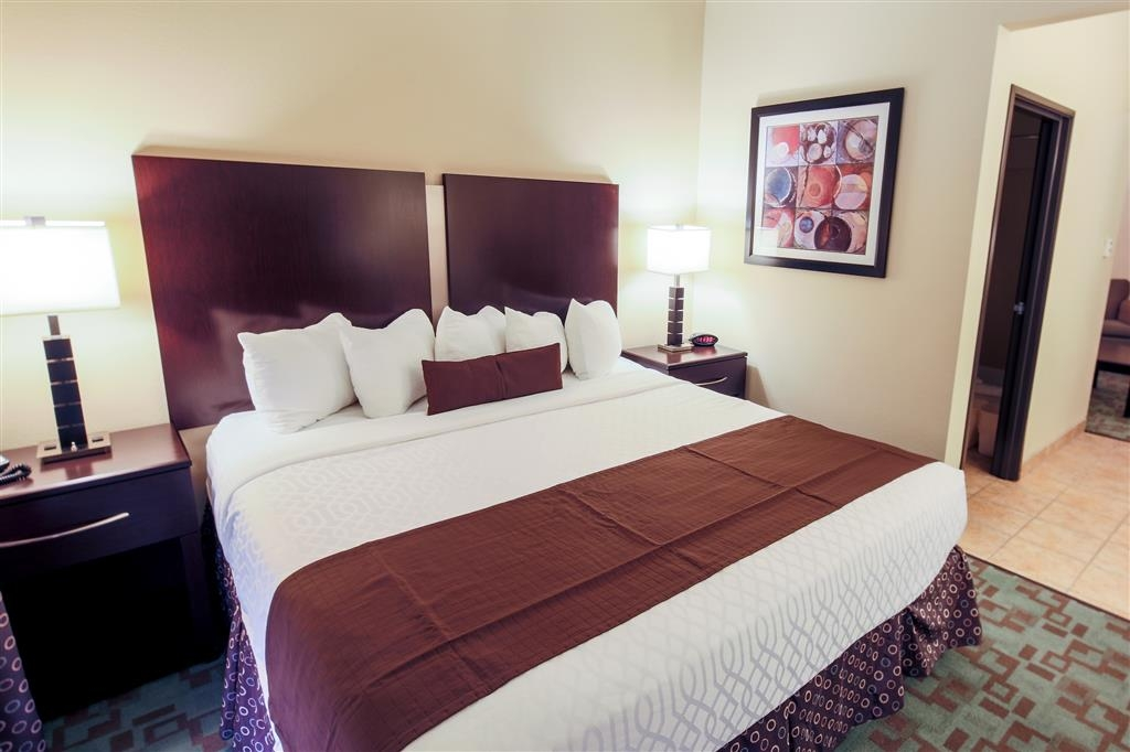 Best Western Plus Eastgate Inn & Suites - The suite bedroom is separated from the living area.