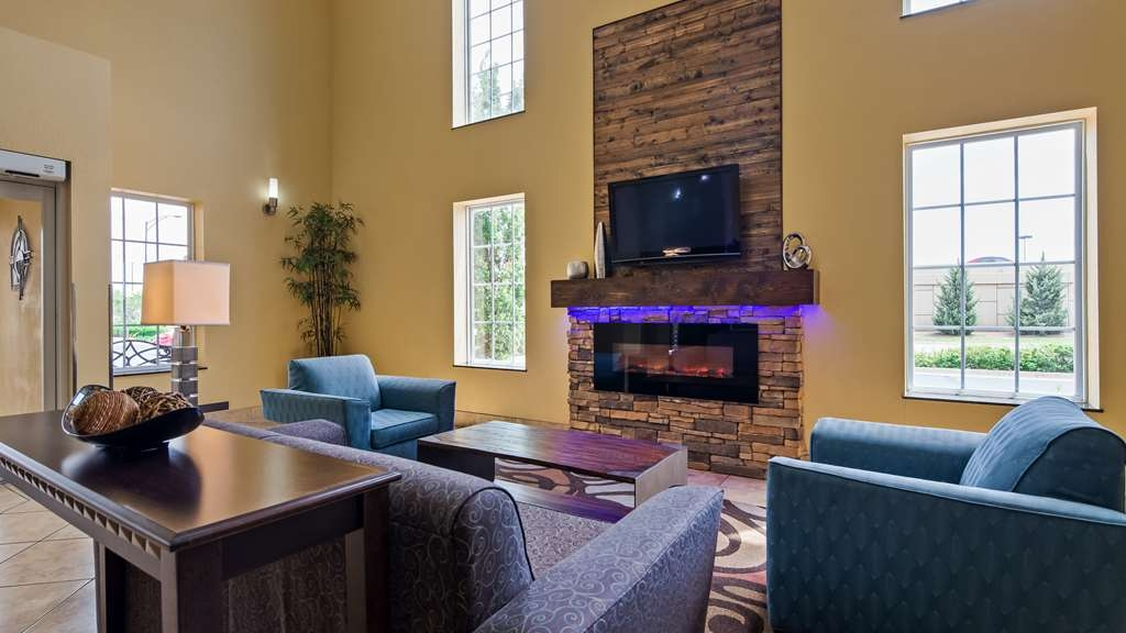 Best Western Plus Eastgate Inn & Suites - Our lobby is the perfect spot to relax by the fireplace after a long day of work or travel.