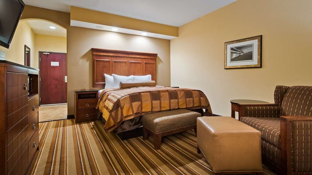 Best Western Premier KC Speedway Inn & Suites - The King Room is perfect for the business traveler.