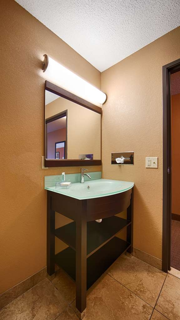 Best Western Paducah Inn - Newly remodeled and clean bathroom with frosted glass sink top.