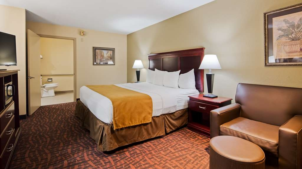 Best Western Eunice - Our king guest room is equipped with a chair, ottoman, and an LED flat screen television.