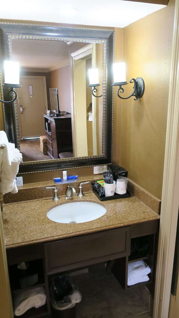 Best Western Plus French Quarter Landmark Hotel - This guest bathroom includes a vanity area with a large mirror and plenty of fresh towels.