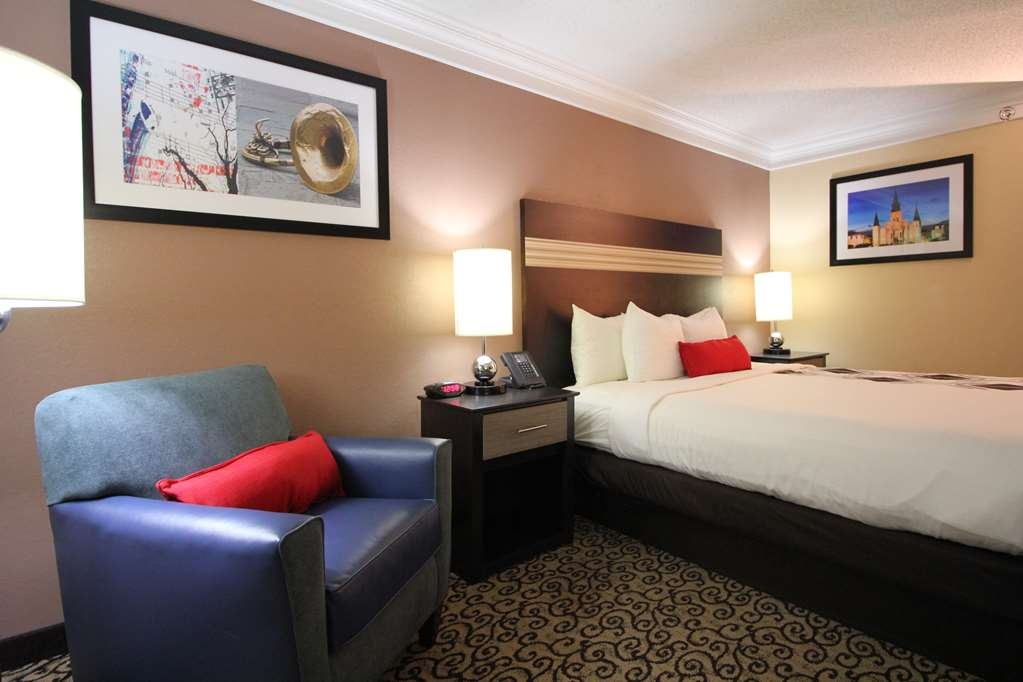 Best Western Plus Slidell Hotel - The cozy comforts of home...a room with 1 King size bed and lounge chair.