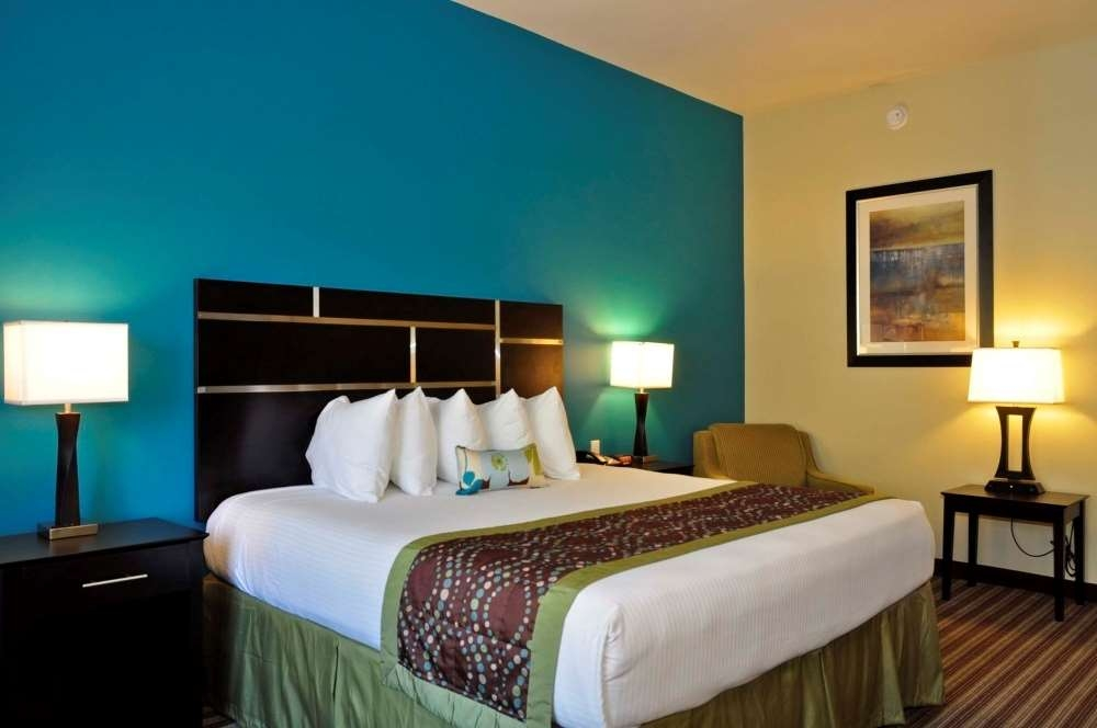 Best Western Plus DeSoto Inn & Suites - Sink into the comfort of our pillow-top mattress in the king guest room.