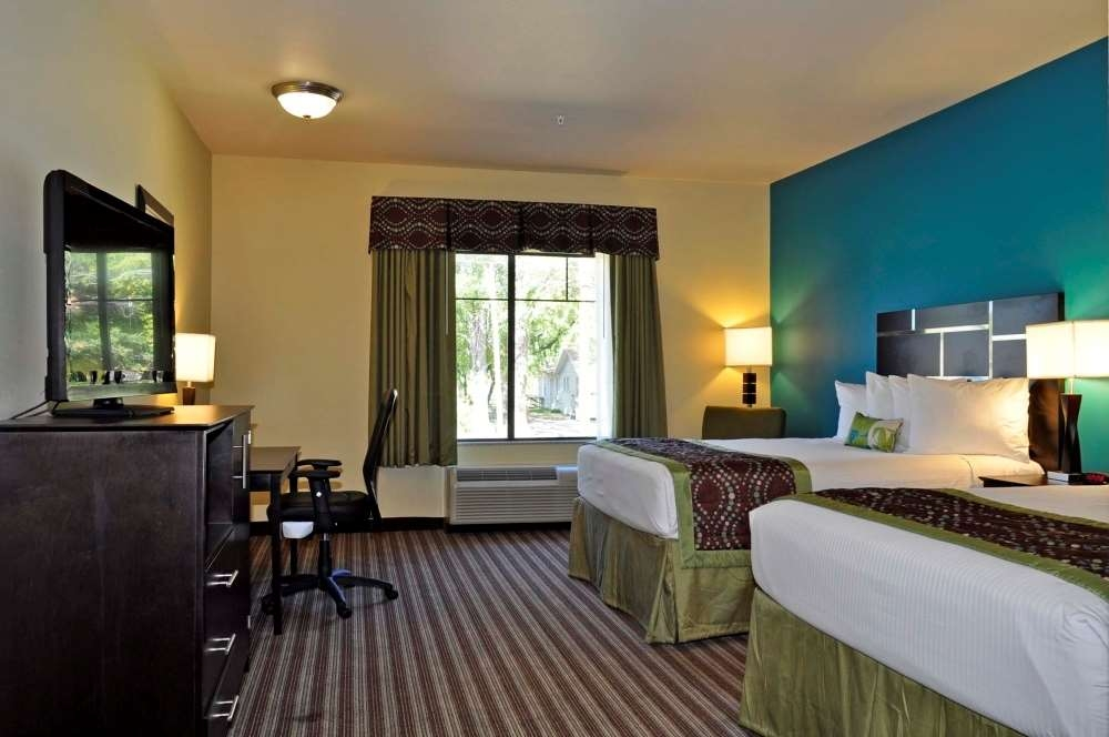 Best Western Plus DeSoto Inn & Suites - Our 2 queen bed guest room includes a 40-inch flat screen television, microwave, and refrigerator.