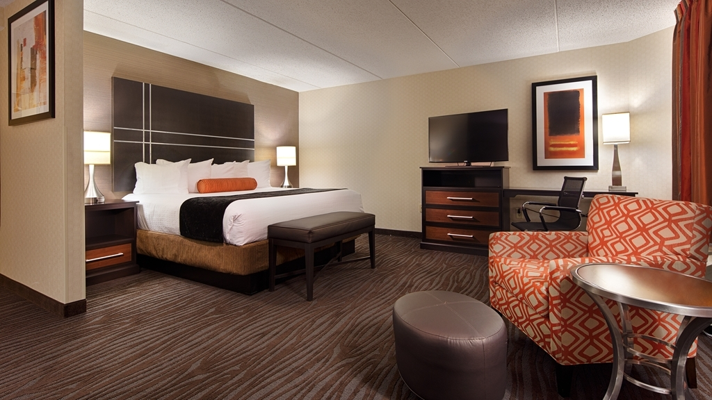 Best Western Plus BWI Airport Hotel - Arundel Mills - Our king suite with a 32-inch flat screen televisions, work stations with ergonomic desk chairs, microwave, refrigerator and more.