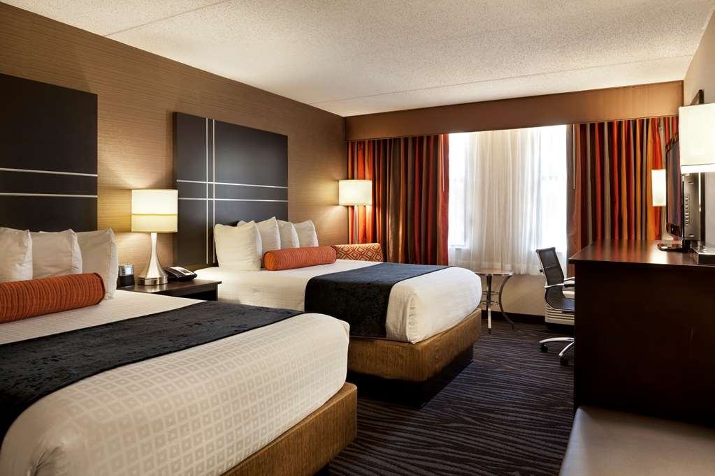Best Western Plus BWI Airport Hotel - Arundel Mills - Two double bed guest room with a 32-inch flat screen television, work station with ergonomic desk chair, microwave, refrigerator and more.