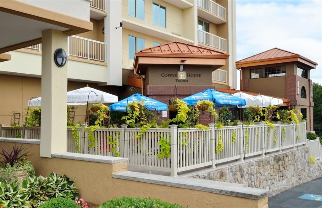 Best Western Plus Waltham Boston - The Copper House Tavern has plenty of space to socialize with family and friends on the outside patio.