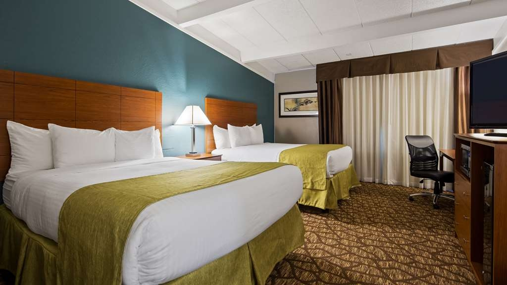 Best Western Hospitality Hotel & Suites - Stretch out and relax in our Two Queen Guest Room.
