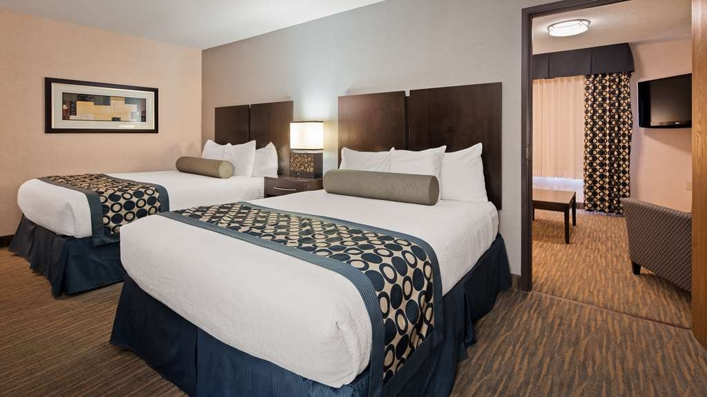 Best Western Plus Coldwater Hotel - Use the separate living room in our two queen suite for entertaining, and keep your sleeping area private.