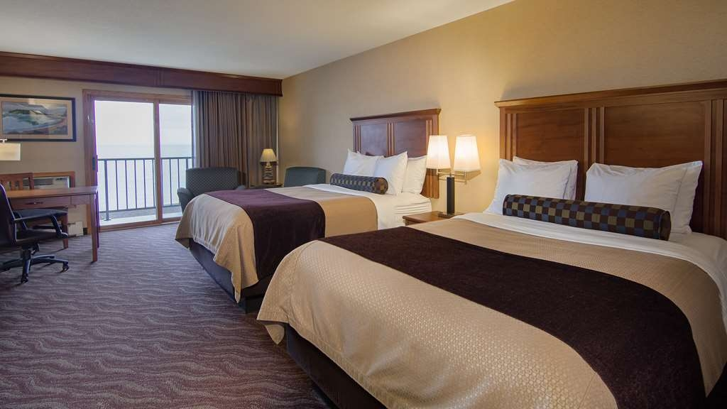 Best Western Plus Superior Inn - Grand Room with two queen beds features a private lakefront balcony, glass-enclosed shower with dual shower heads. Pets not allowed.