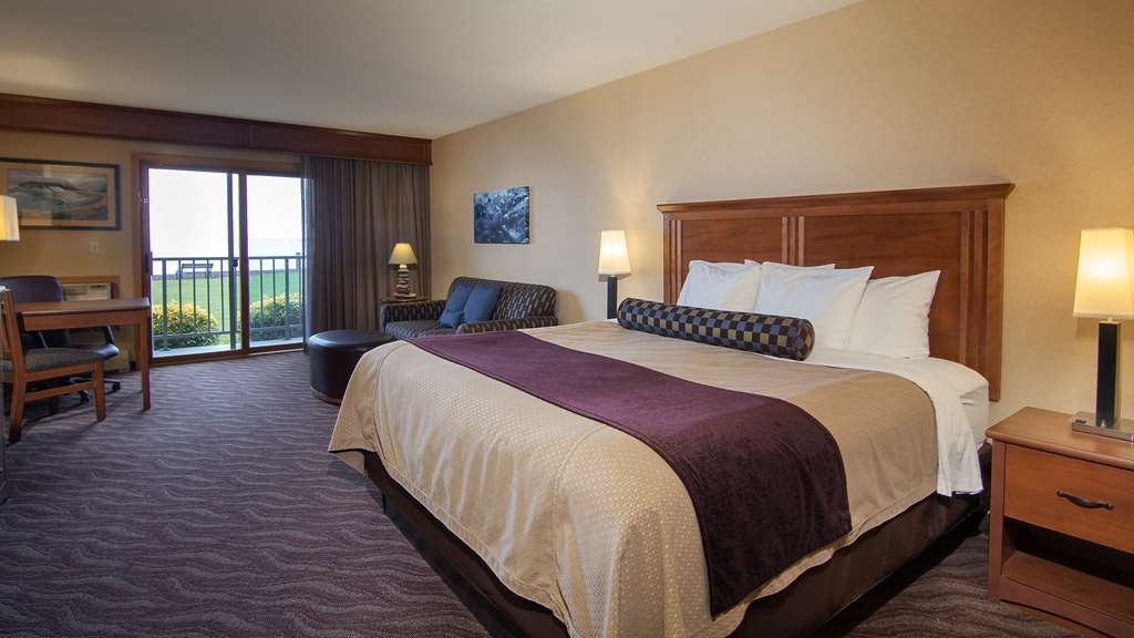 Best Western Plus Superior Inn - Grand Room with one king bed, sofa bed, private lakefront balcony, glass-enclosed shower with dual shower heads. Pets not allowed.