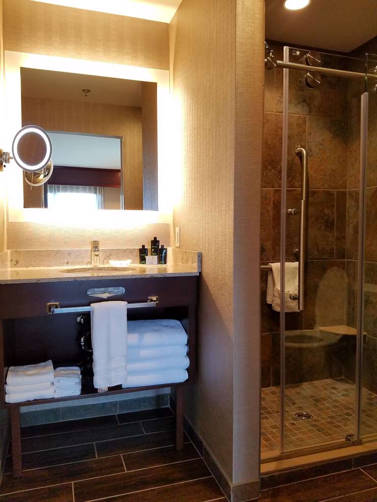 Best Western Plus Superior Inn - Newly renovated corner fireplace room features a walk in glass door shower and make up mirror.