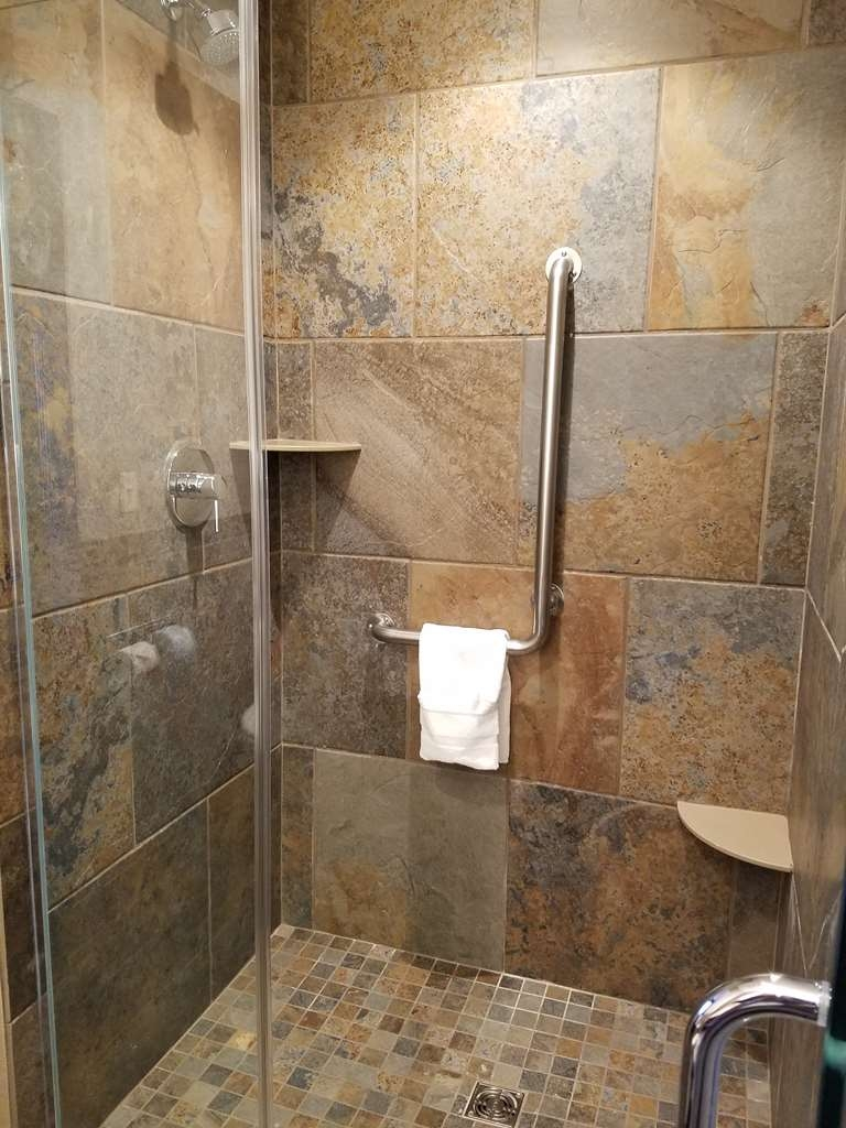 Best Western Plus Superior Inn - New walk in shower is featured in the newly renovated standard rooms with one king bed.