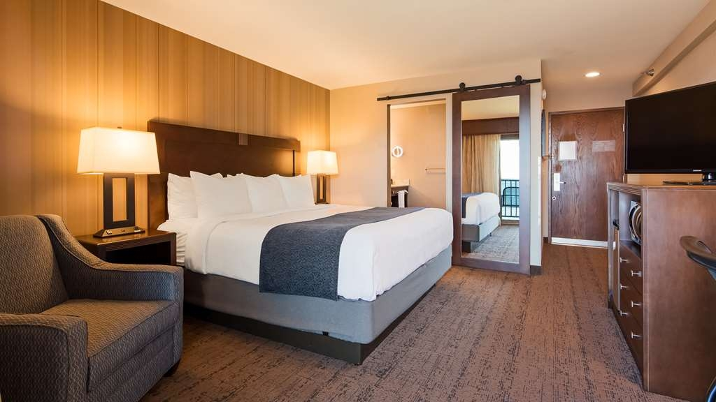 Best Western Plus Superior Inn - Newly remodeled! Standard lakefront room with one king bed and private balcony. Bathroom features a barn door entrance, walk-in glass enclosed shower, lighted makeup mirror