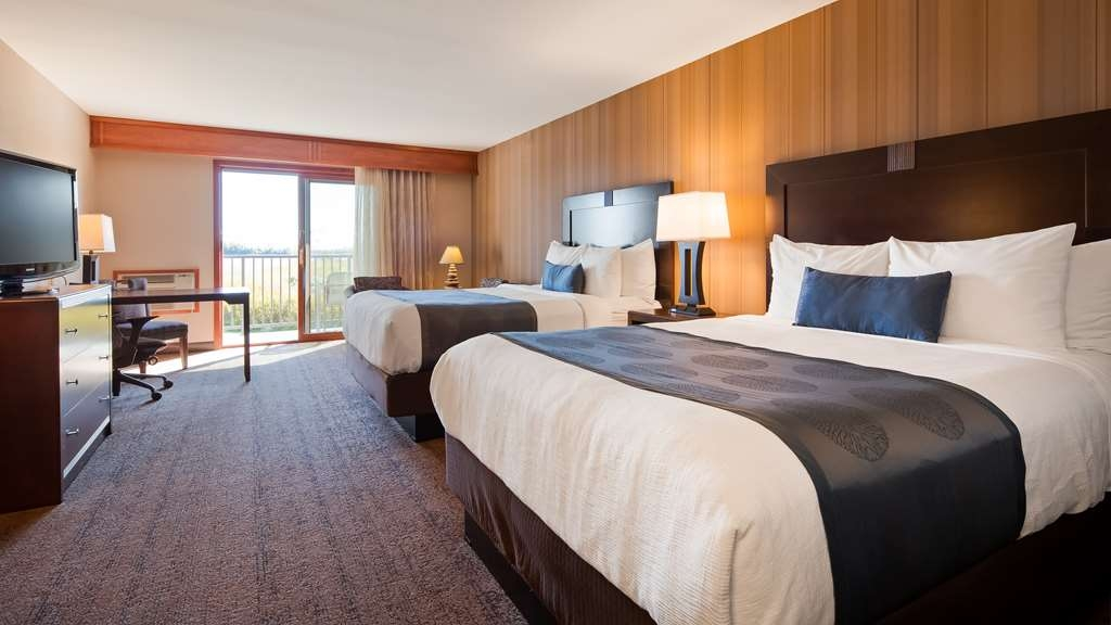 Best Western Plus Superior Inn - John Beargrease Wing - spacious lakefront room with two queen beds and private lakefront balcony with partial lake view. Stairs are required.