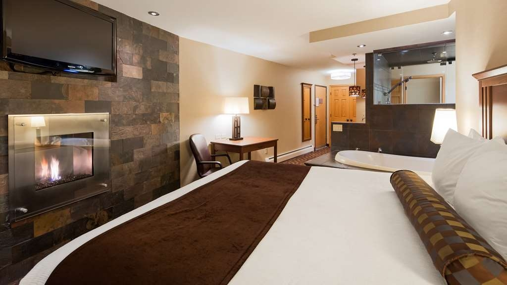 Best Western Plus Superior Inn - Renewal Steam Shower Suite: Rejuvenate in this luxurious lakefront room with one king bed, glass enclosed steam shower with five shower heads, gas fireplace, hydrotherapy whirlpool, bathrobes and private lakefront balcony overlooking Lake Superior.