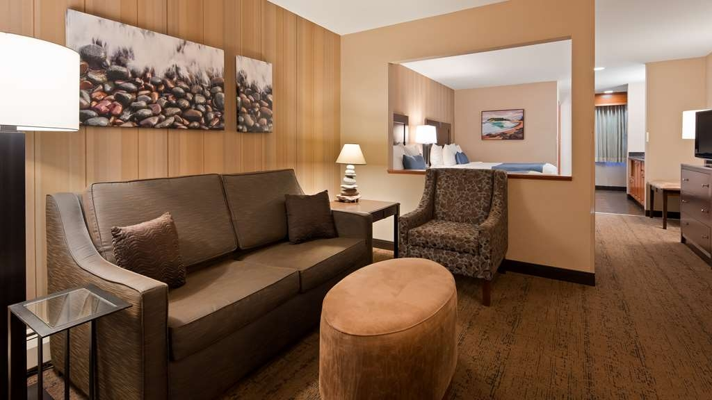 Best Western Plus Superior Inn - John Beargrease Wing Minisuite - spacious room with two queen beds, two TVs with a half wall dividing the sleeping and living area. Room includes wet bar. Bathroom features tub-shower.