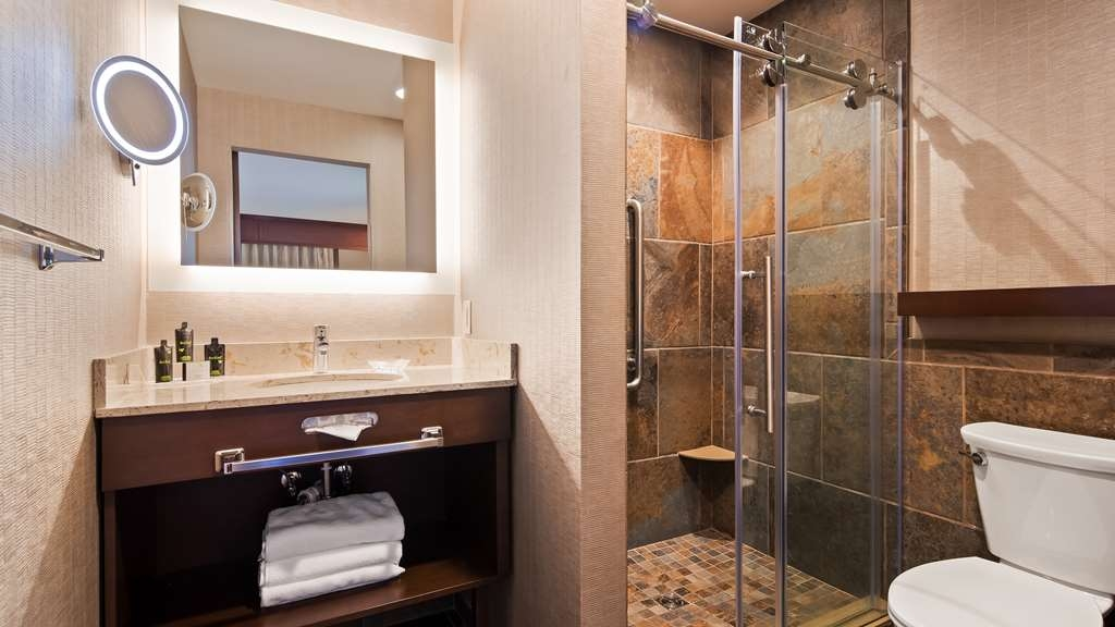Best Western Plus Superior Inn - Newly remodeled bathroom features walk-in shower and lighted makeup mirror.