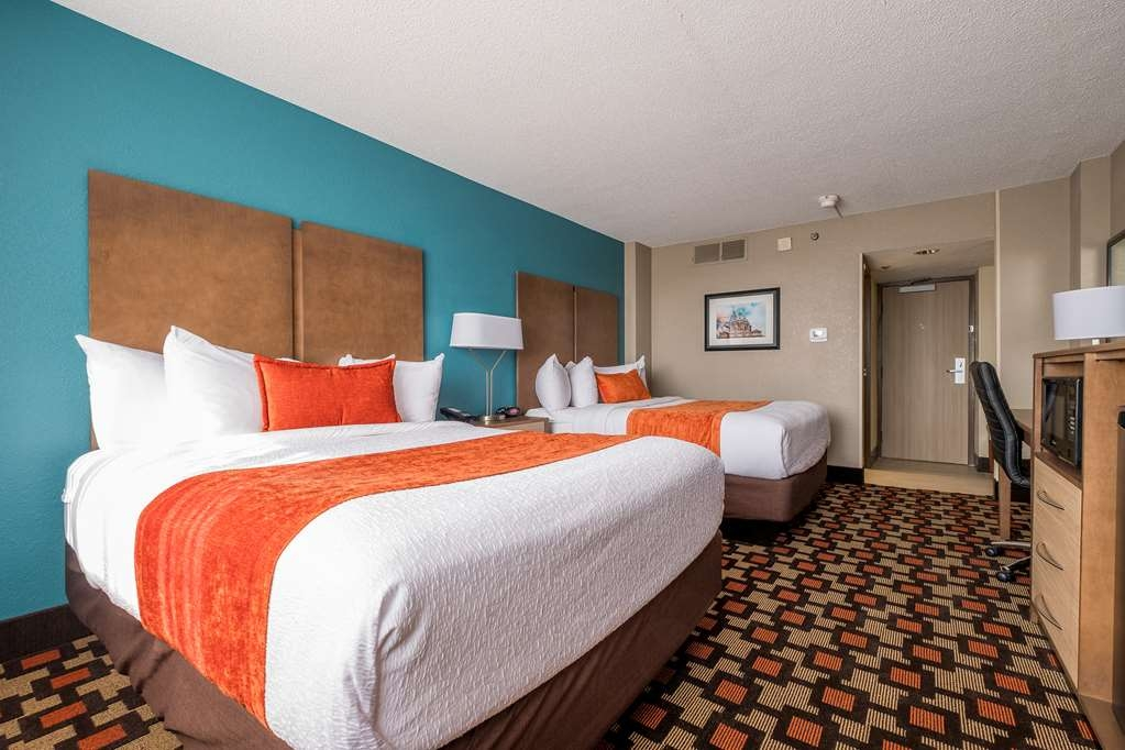 Best Western Plus Capitol Ridge - Standard double queen guest room also includes a fridge and a microwave and Wi-Fi.