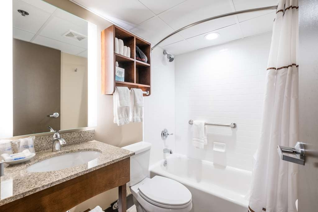Best Western Plus Capitol Ridge - Newly renovated bathrooms feature a new sink and shower area with convenient shelving for all of your accessories.