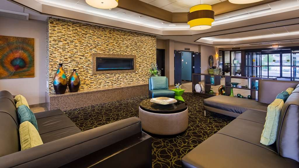Best Western Plus Kelly Inn - Relax and unwind in our lobby by the state of the art fireplace.