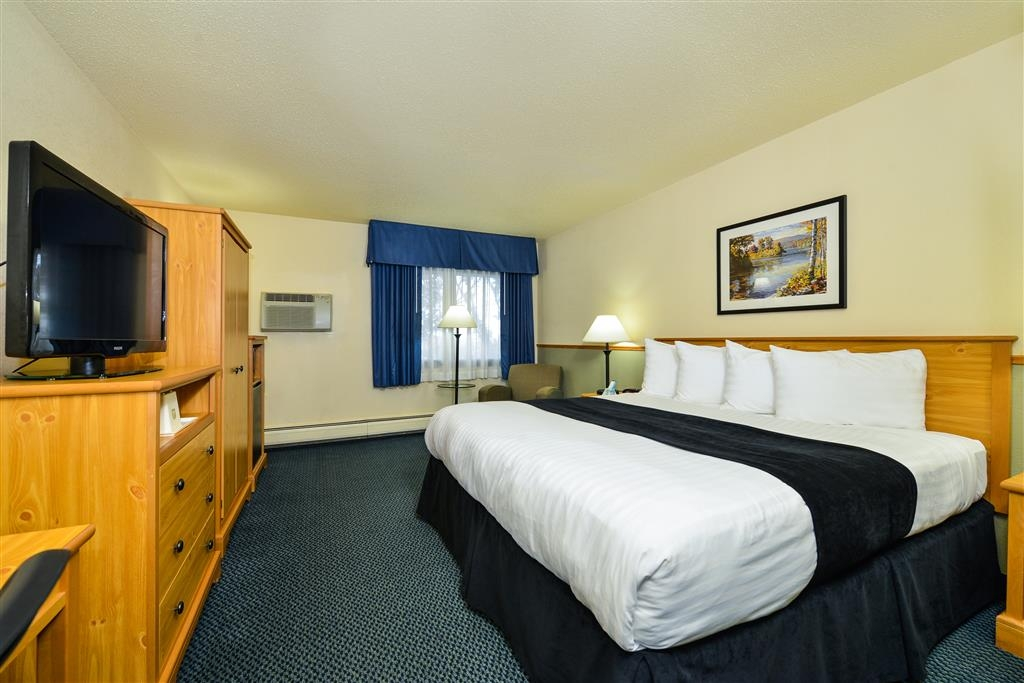 Best Western Bemidji - Our spacious king guest room has all the comforts of home at your fingertips including a comfy lounge chair, microwave and refrigerator.