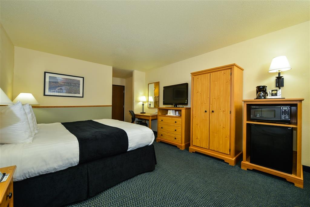 Best Western Bemidji - Room features one comfy king size bed, wireless Internet, 37-inch television, lounge chair, desk, microwave and refrigerator.