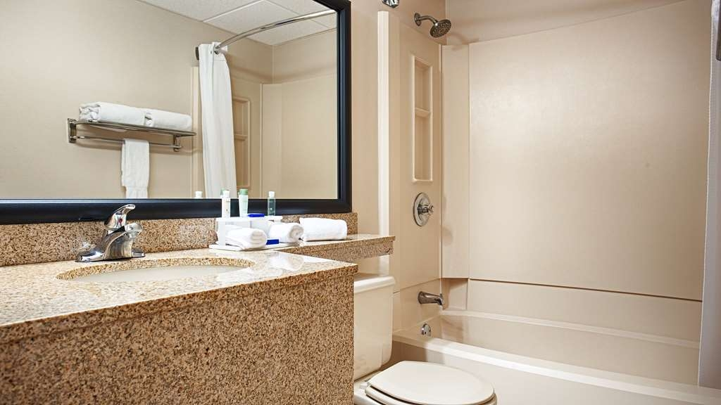 Best Western Plus Como Park Hotel - All guest bathrooms have a large vanity with plenty of room to unpack the necessities.