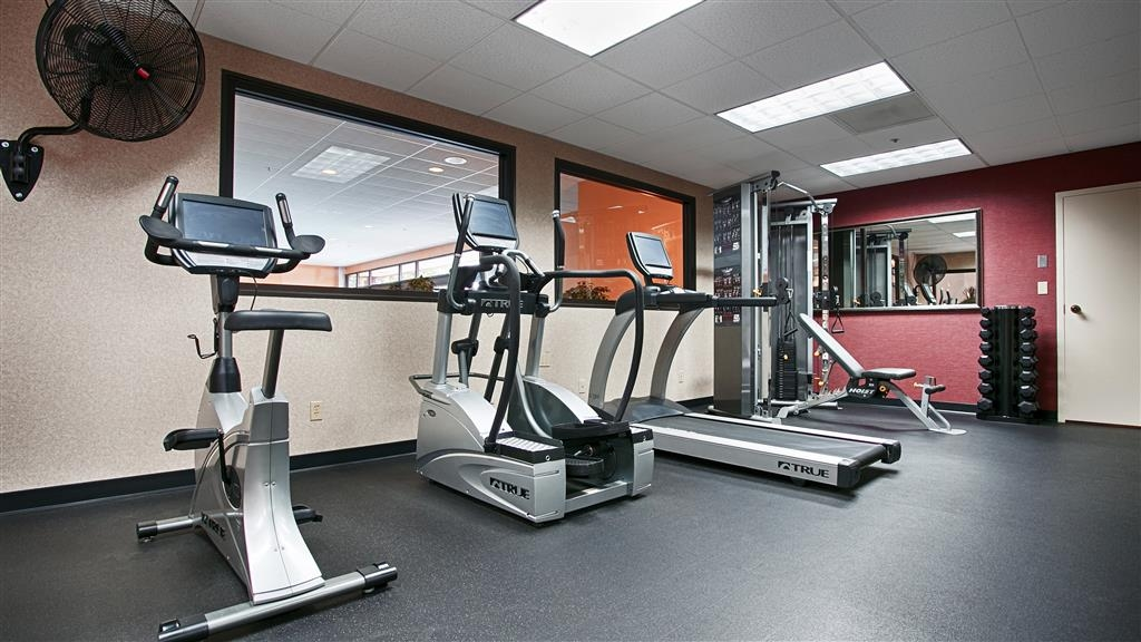 Best Western Premier Nicollet Inn - Take advantage of our fitness center with built-in TVs and view of the pool.