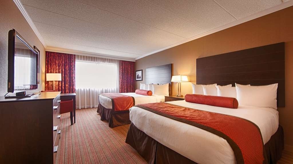 Best Western Premier Nicollet Inn - Make a reservation in our double queen room featuring a terrace, balcony, microwave and refrigerator.
