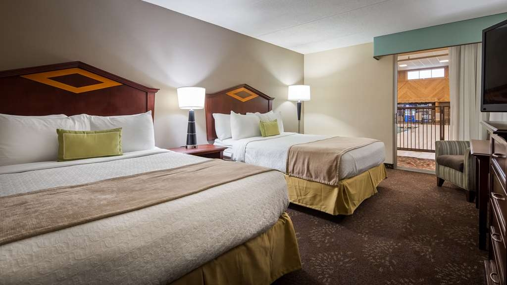 Best Western Plus Willmar - Relax poolside in our Two Queen Guest Room.