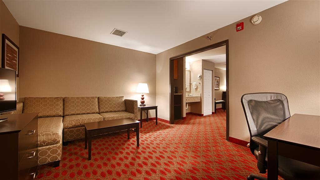Best Western Plus Minneapolis-Northwest - Use the separate living room in our suite king for entertaining, and keep your sleeping area private.
