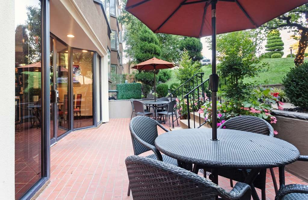 Best Western Plus Seville Plaza Hotel - Our patio is the perfect place to sit and chat with friends.